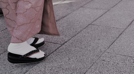Photo of feet in traditional kimono at Asakusa Shrine in Tokyo, Japan