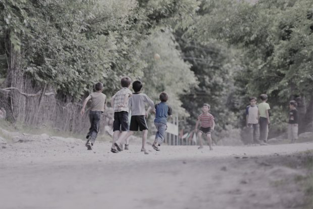 Photo of boys playing football near Khorog, Tajikistan