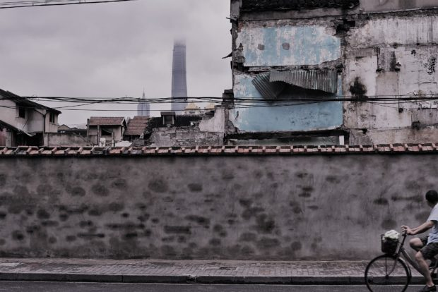 Photo of demolished Hutong with Shanghai Financial Centre Tower in distance, China