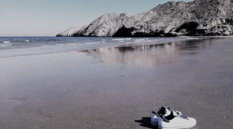 Photo of sneakers on Al Sifah Beach near Muscat, Oman